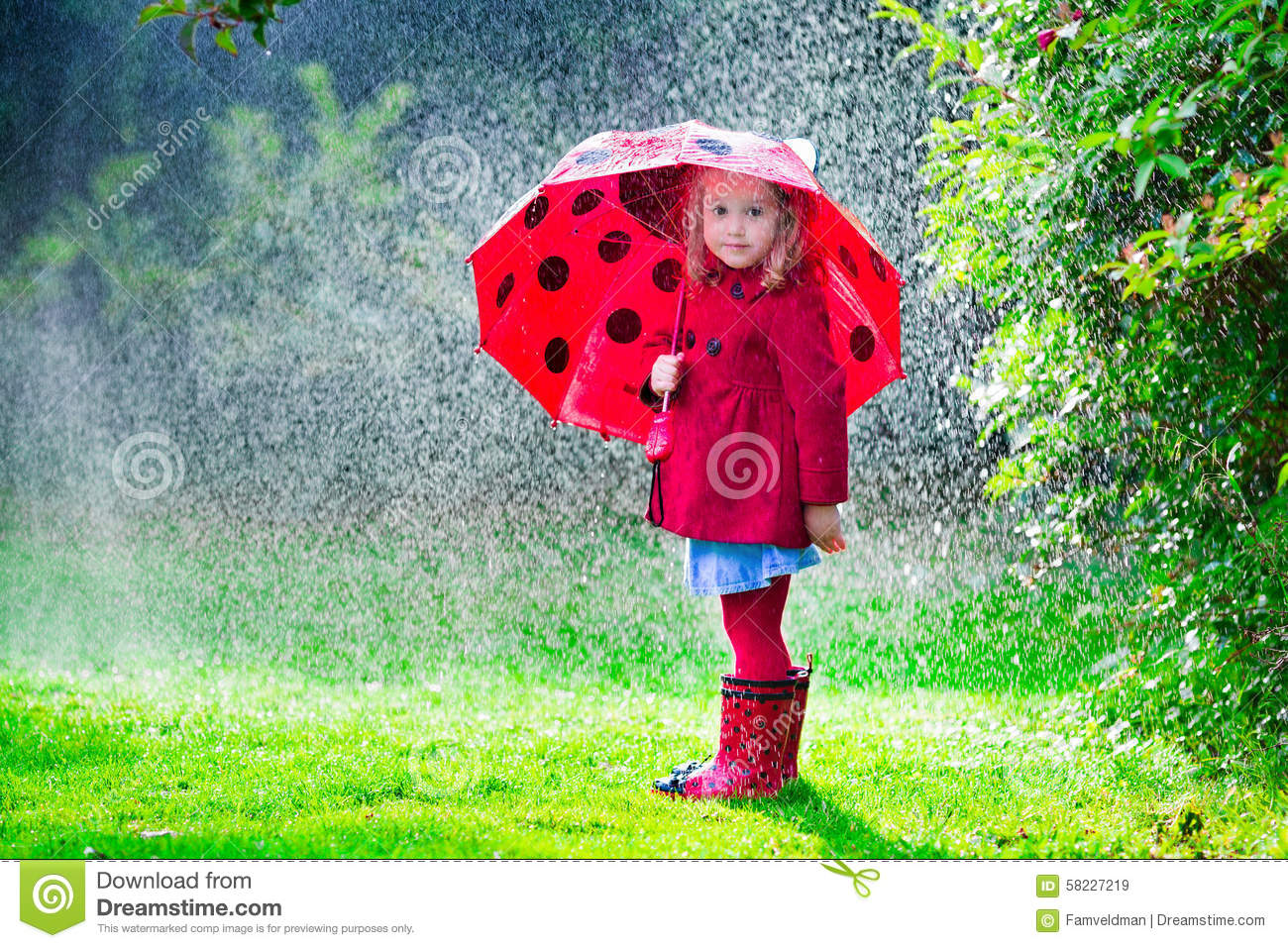 Little girl with red umbrella playing in the rain. Kids play outdoors ...