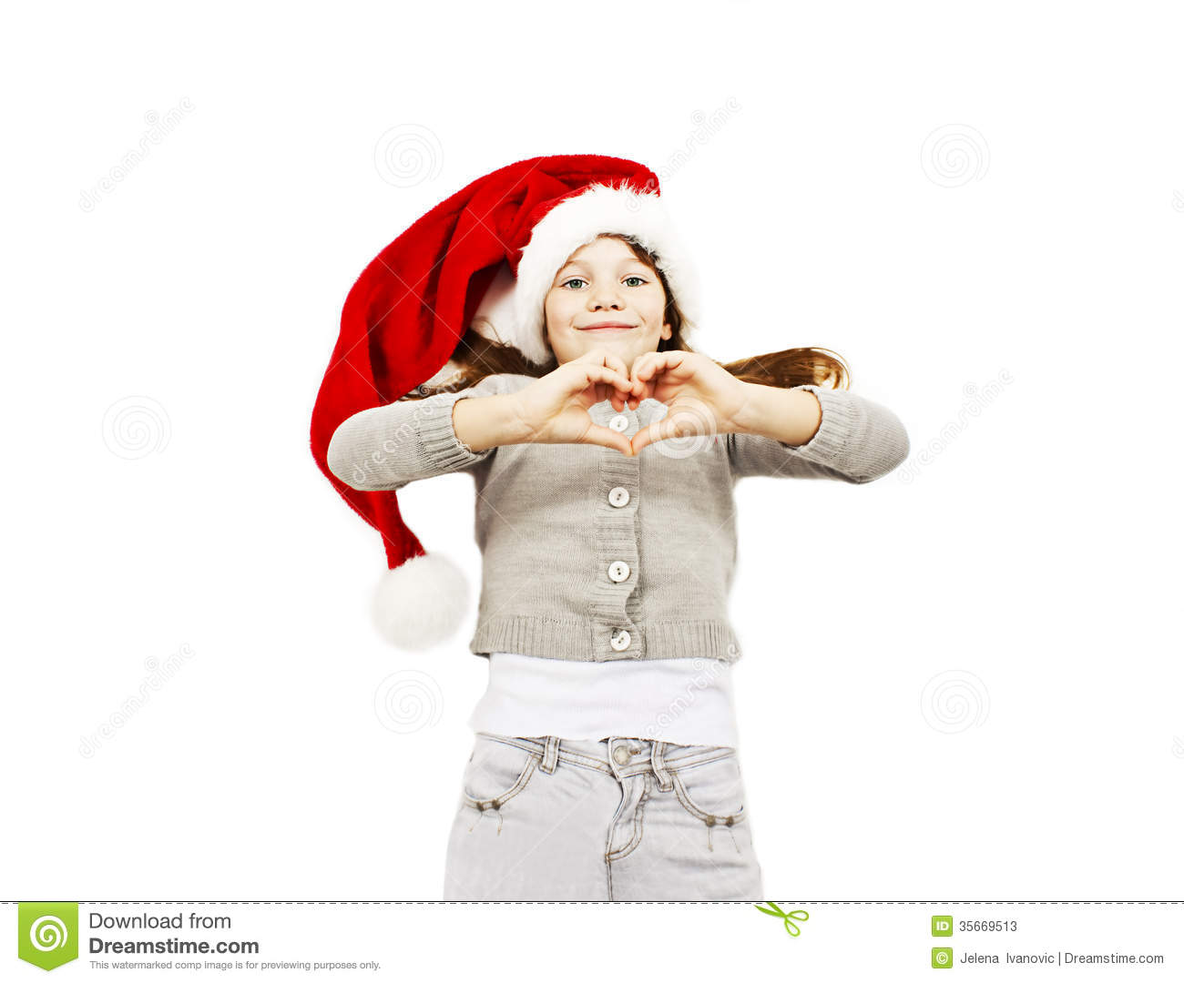 Little girl in red Santa hat making the heart with her hands