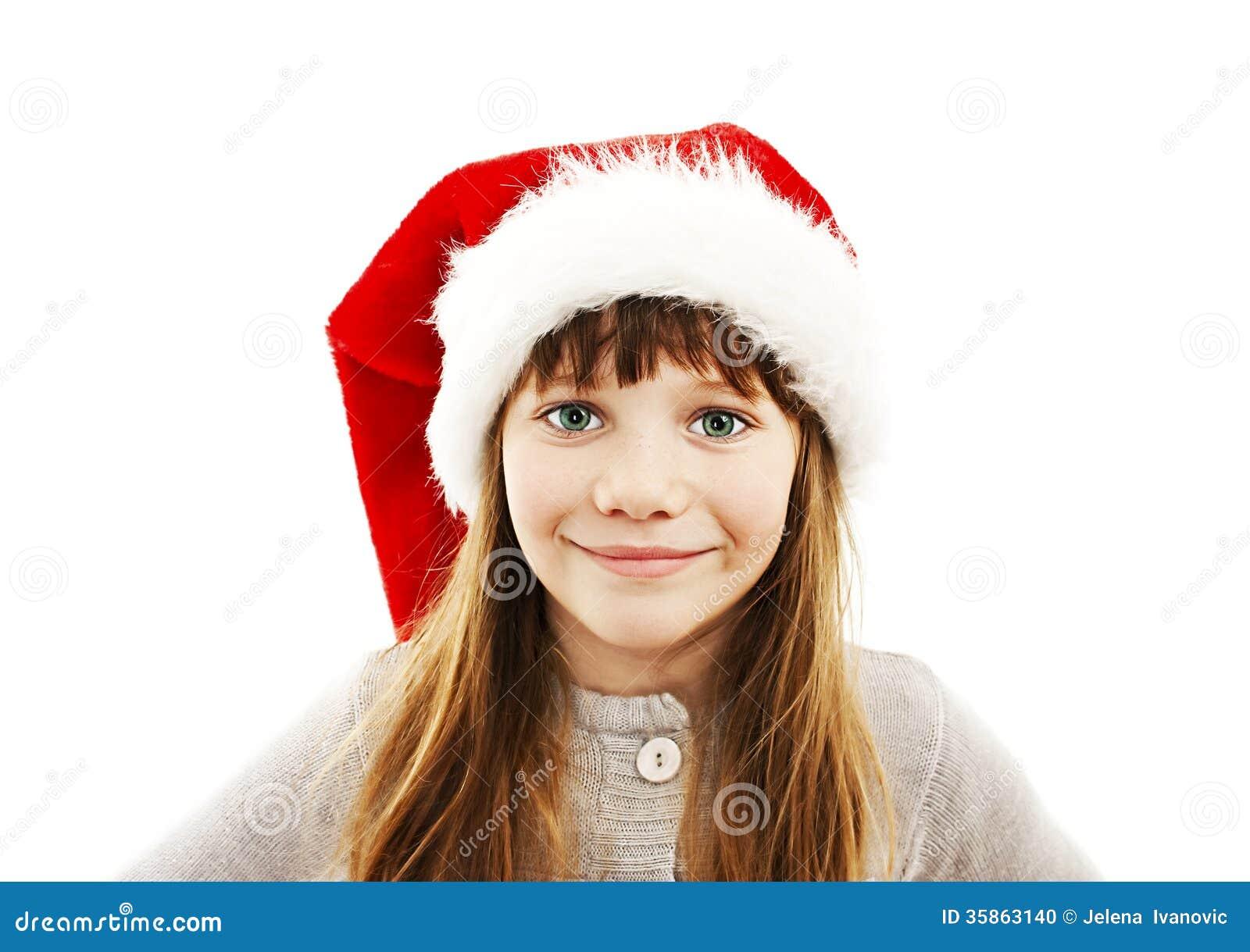 Little girl in red Santa hat. Portrait