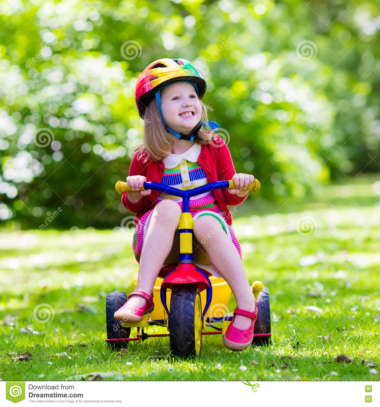 bd7ed3325f6 Little Girl Riding A Tricycle Stock Image - Image of preschool ...