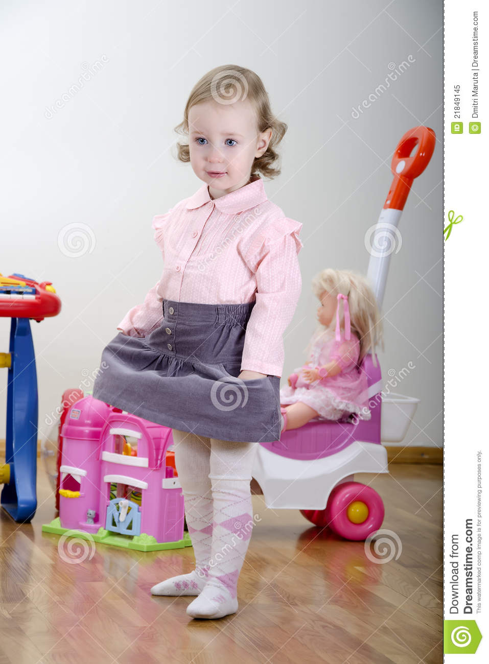 Little Girl Toys : Little girl in a room with toys royalty free stock photo