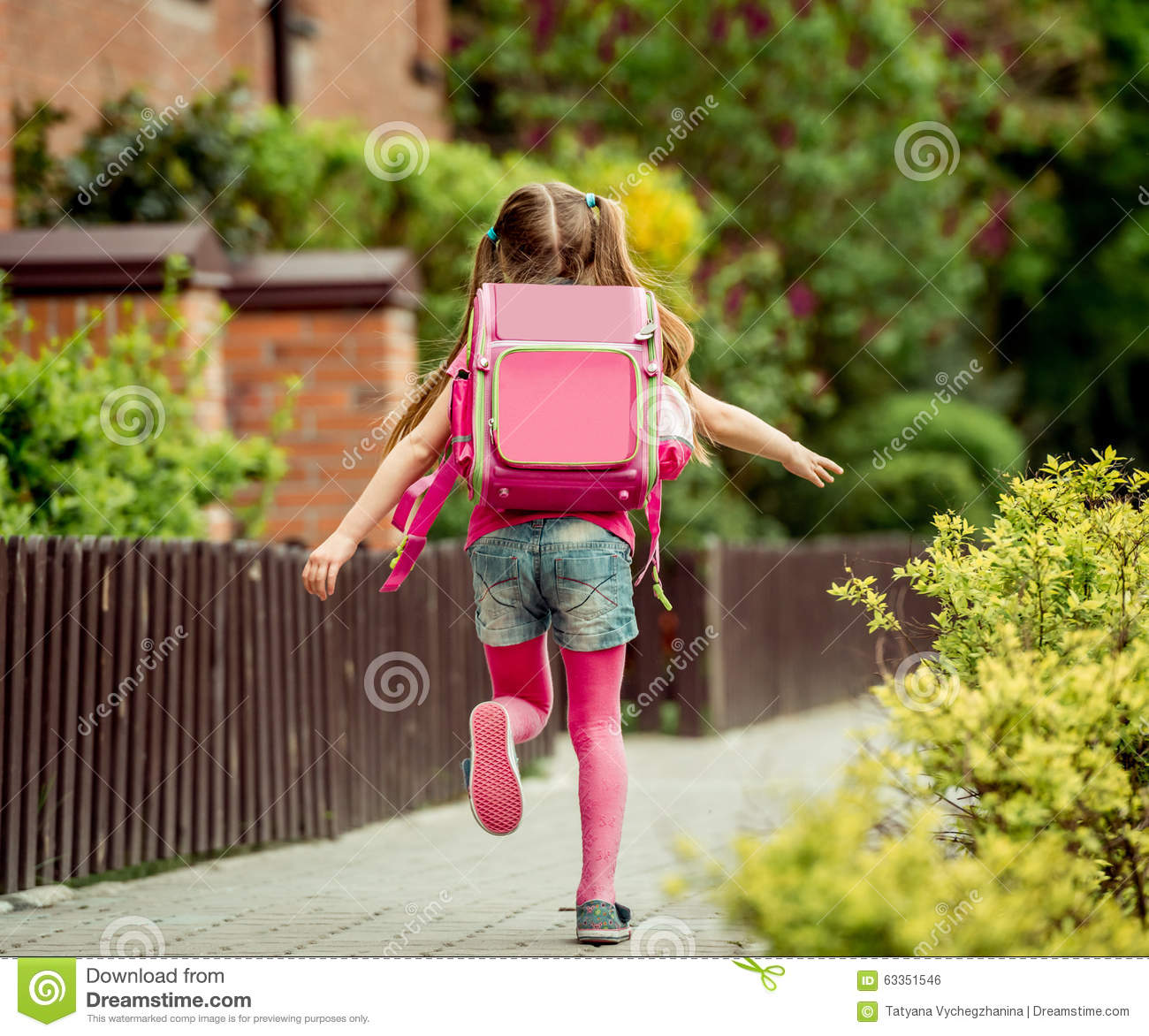 a87571091d Little girl run to school stock photo. Image of back - 63351546