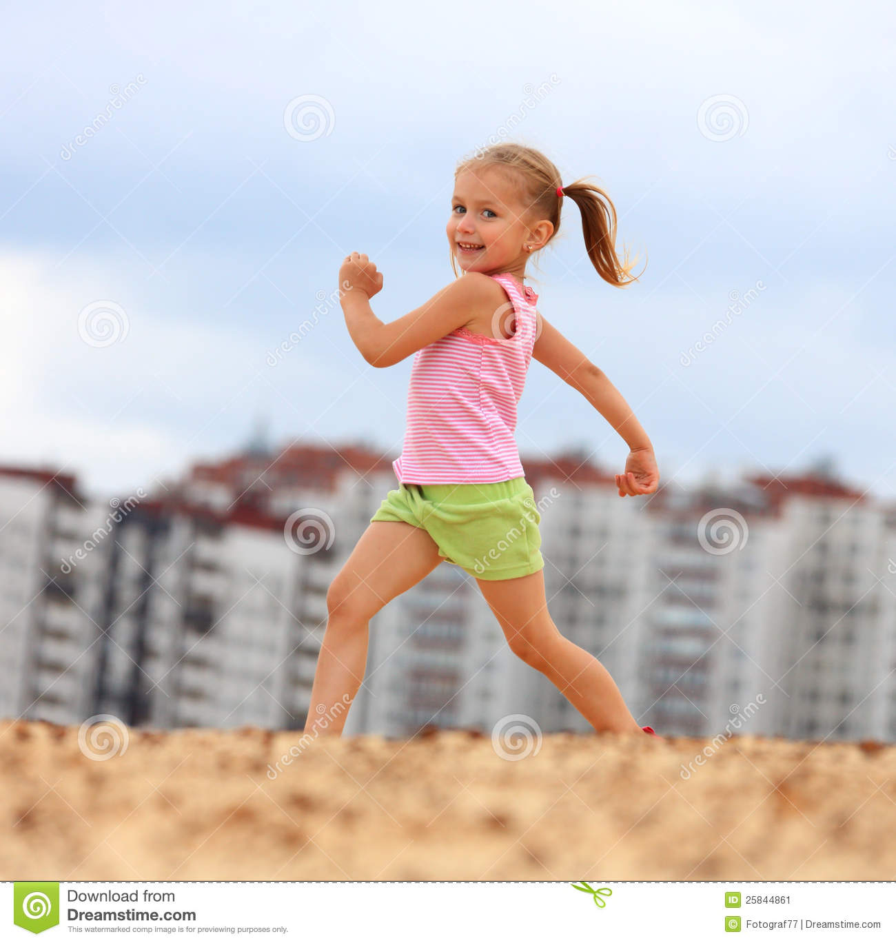 little girl running in sand stock photo image of child ready