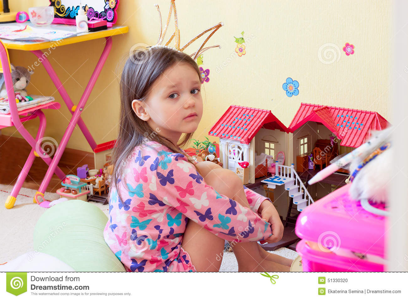 Little Girl Toys : A little girl is sad among the toys stock photo image