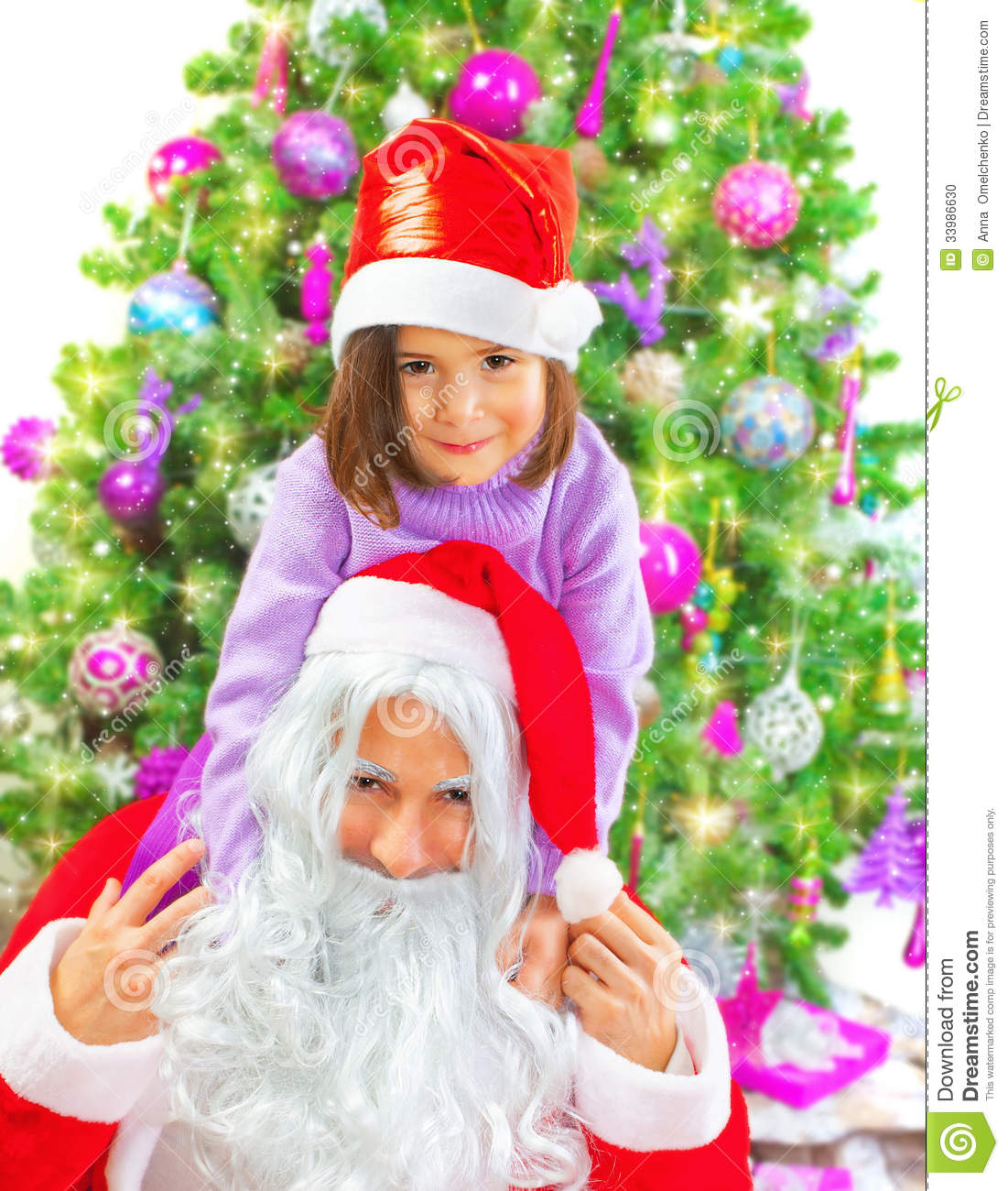 Little Girl Christmas Tree: Little Girl With Santa Claus Stock Photo