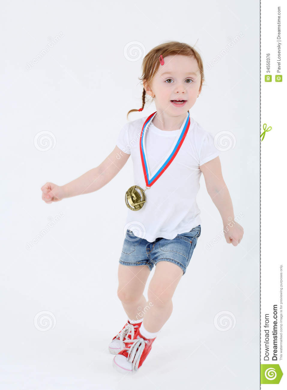 Little Girl In Shorts With Medal On Her Chest Runs Royalty ...