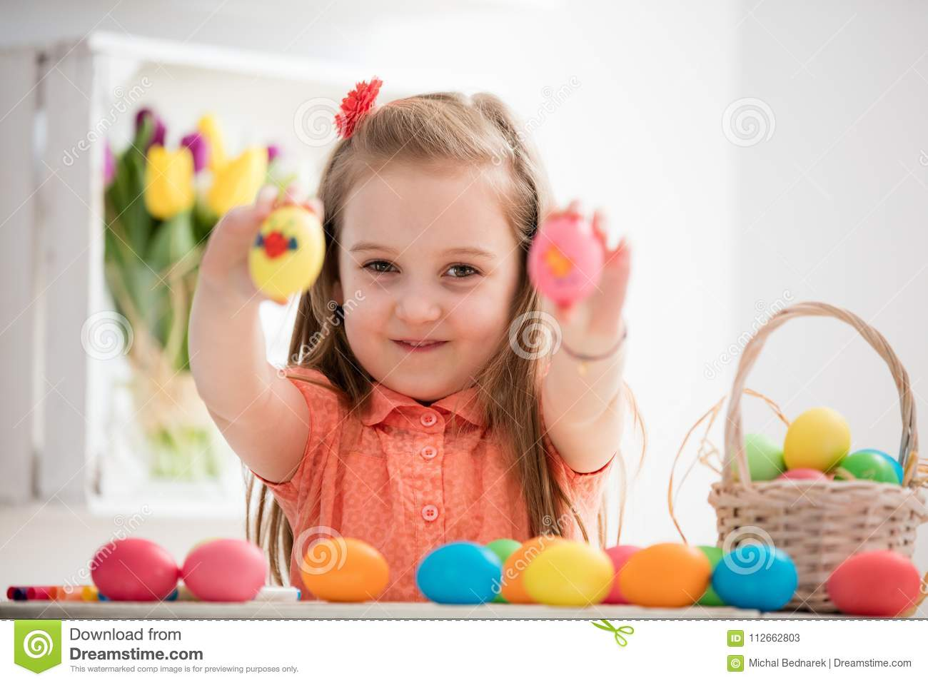 Little girl showing her hand-painted colorful eggs.