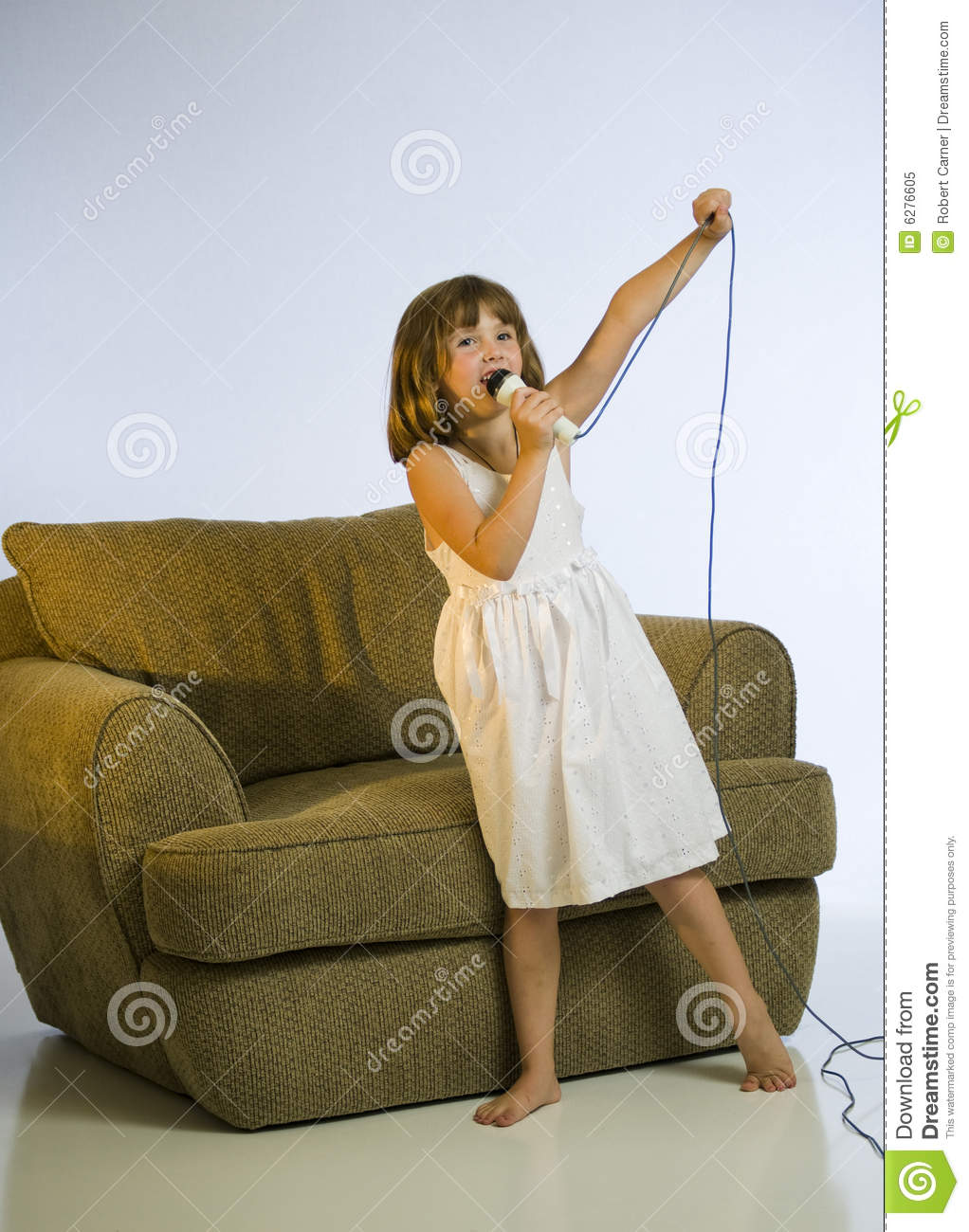 Little Girl Singing In A Microphone Stock Image - Image of ...