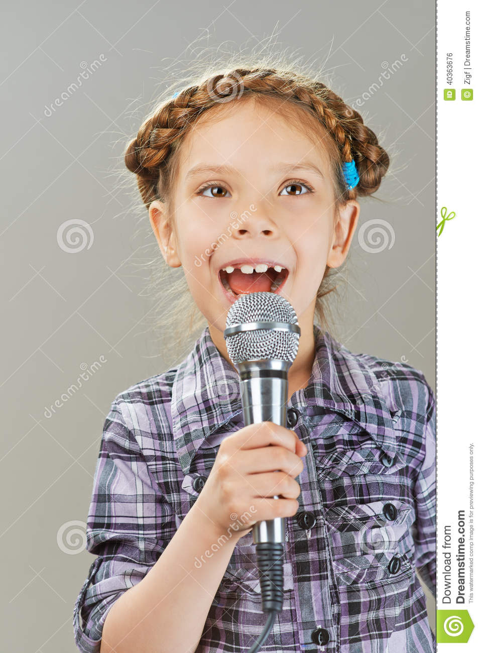 Little Girl Singing Into Microphone Stock Photo - Image ...