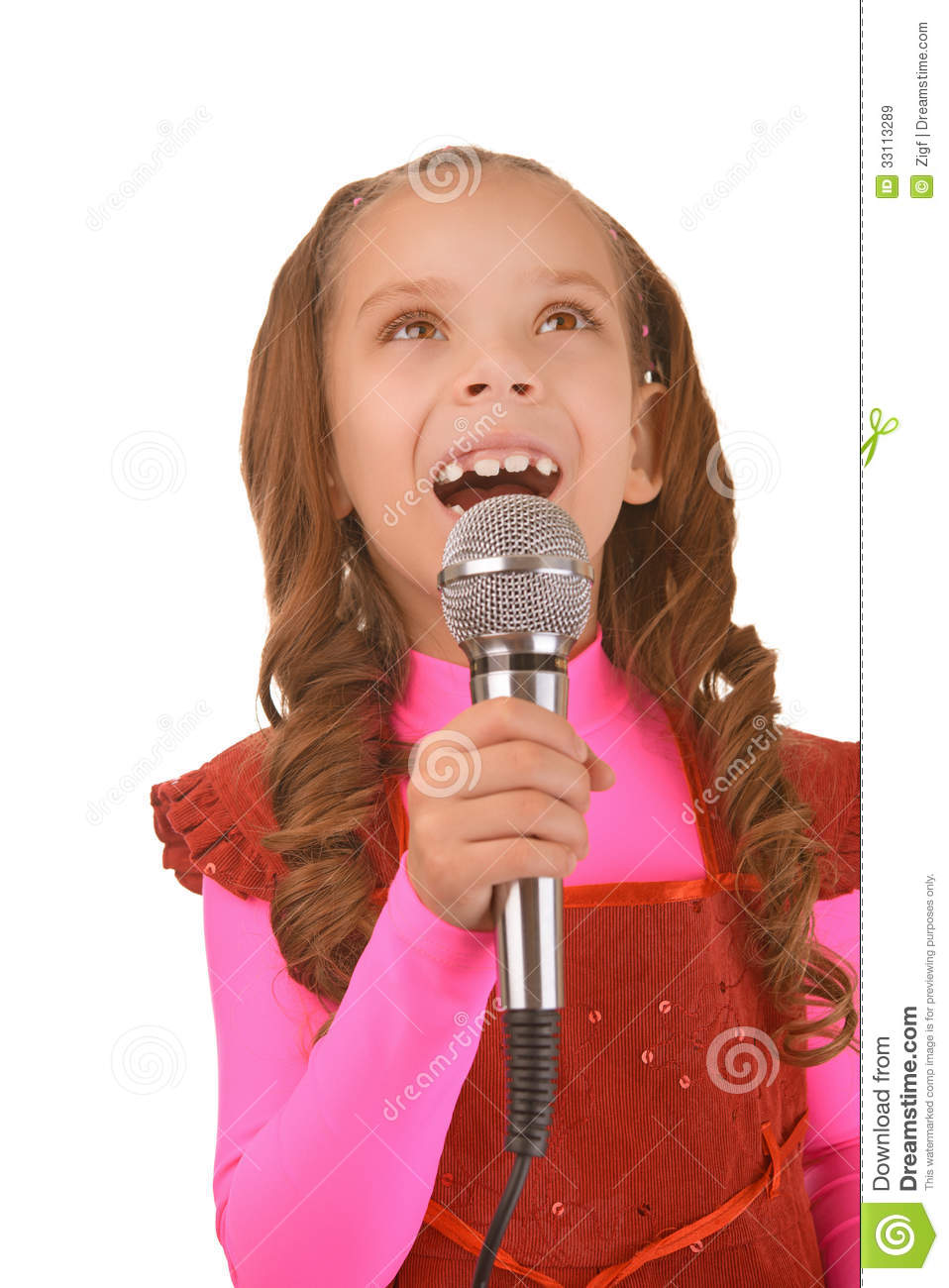 little girl singing into microphone royalty free stock