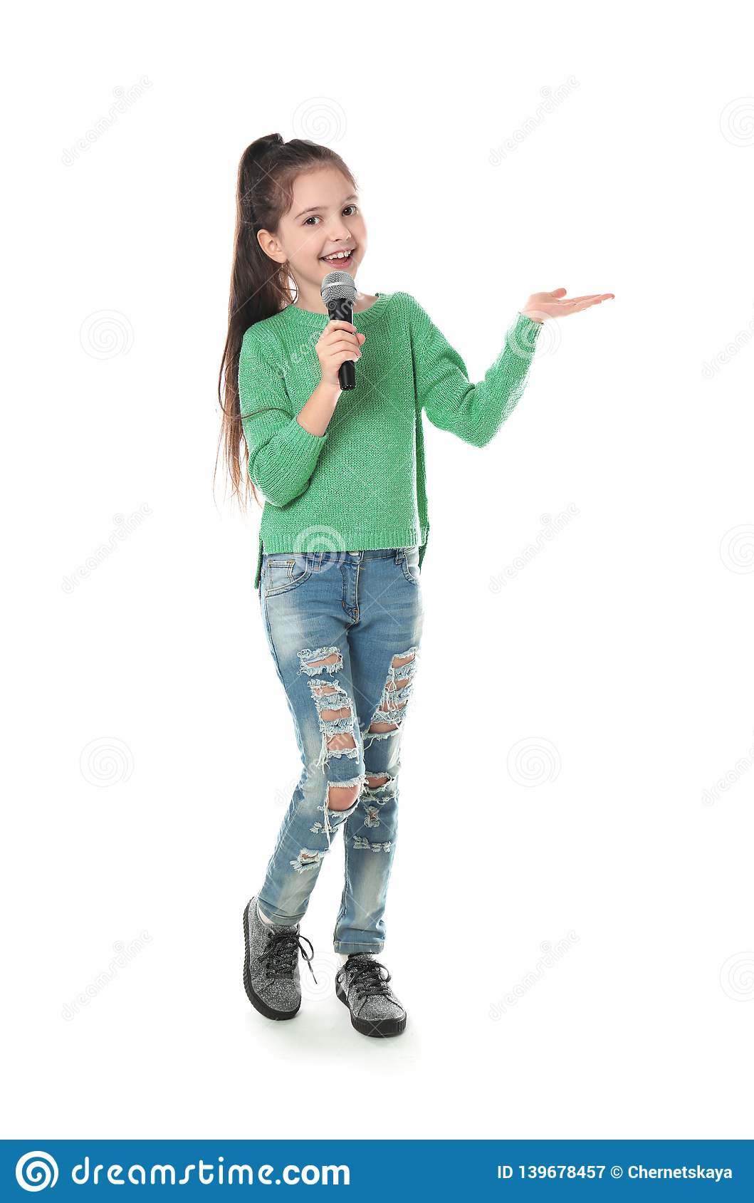 Little Girl Singing Into Microphone Stock Image - Image of ...