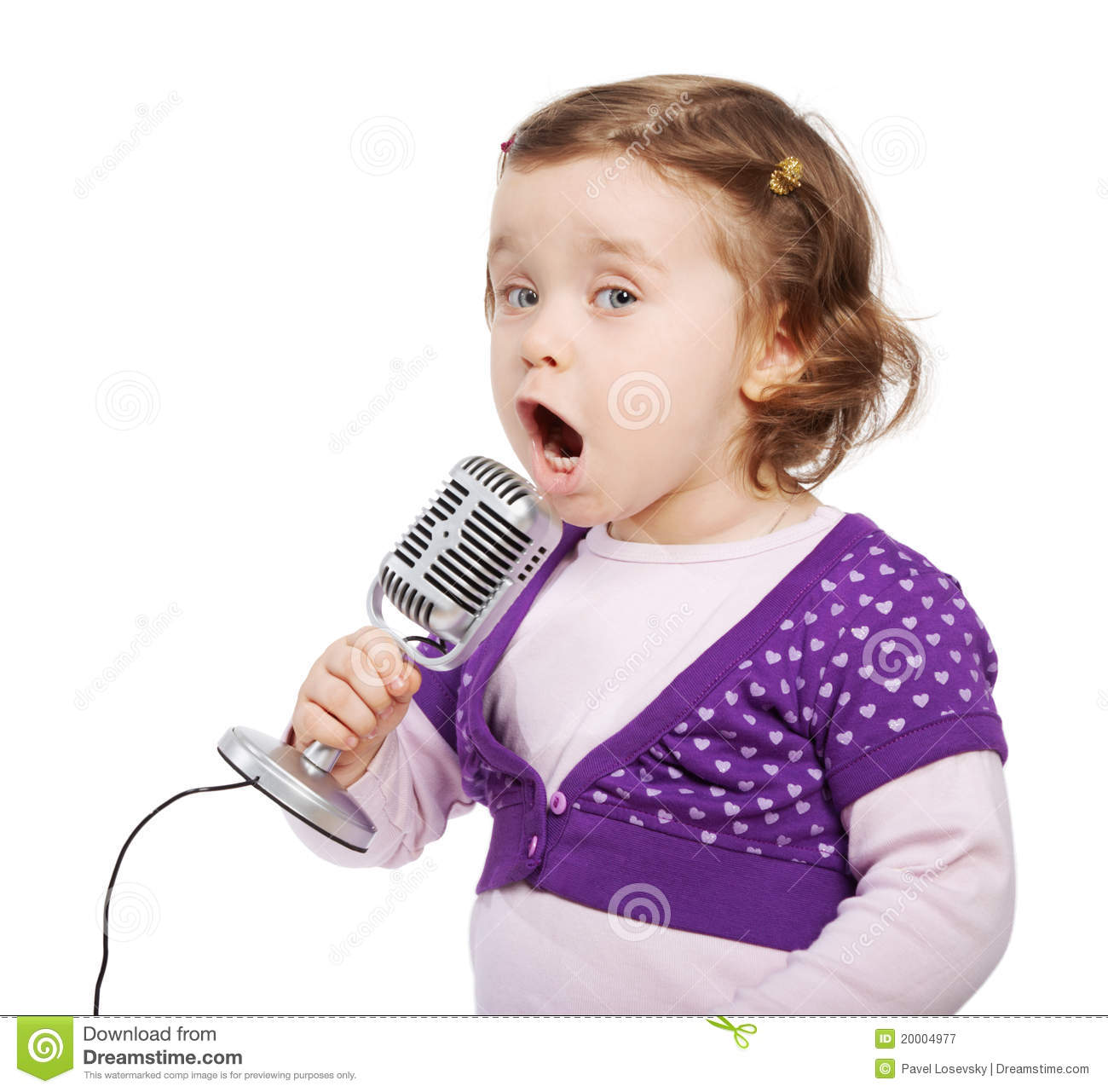 little girl sings into the microphone stock image   image