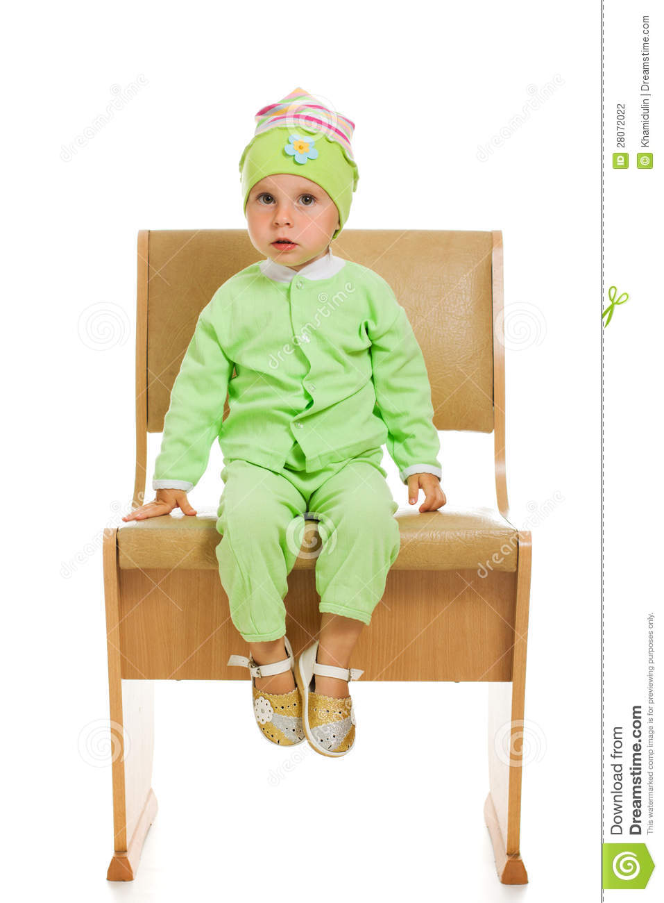 the little girl sits on a high chair stock photography 28072022. Black Bedroom Furniture Sets. Home Design Ideas