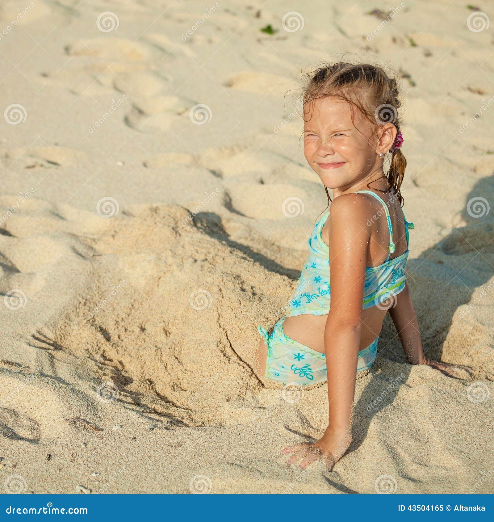 Little Girl Sitting On The Beach Stock Image