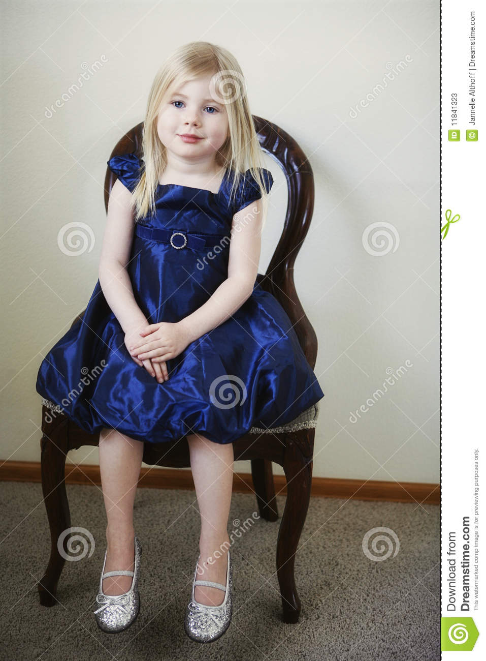 Little Girl Sitting In Chair Stock Image