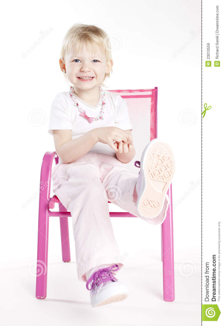 little girl sitting on chair royalty free stock images image 23010559. Black Bedroom Furniture Sets. Home Design Ideas