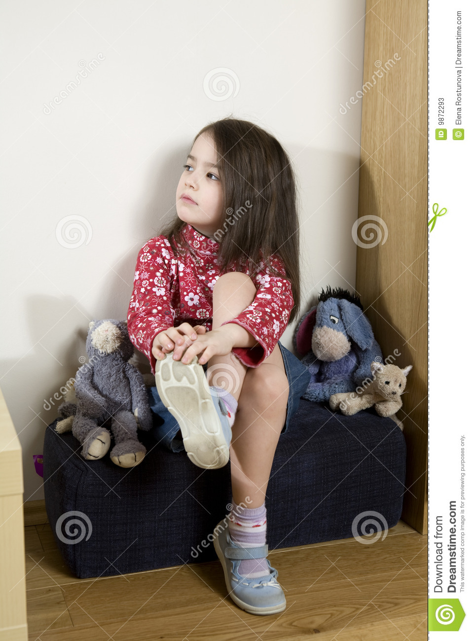 little girl sitting on chair stock photos image 9872293. Black Bedroom Furniture Sets. Home Design Ideas