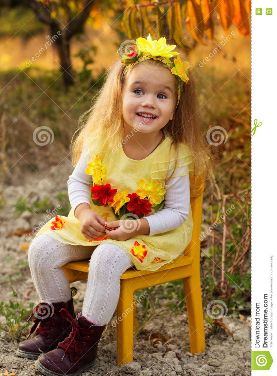 Little Girl Is Sitting On Chair In Autumn Garden Stock Image - Image ...