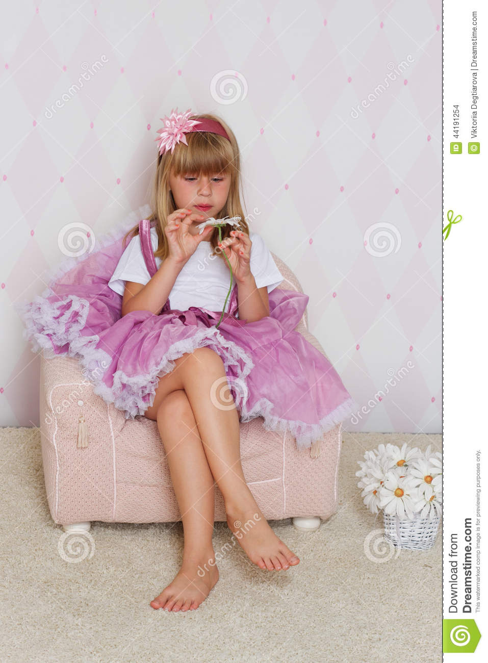 Little Girl Is Sitting On A Chair Stock Photo Image