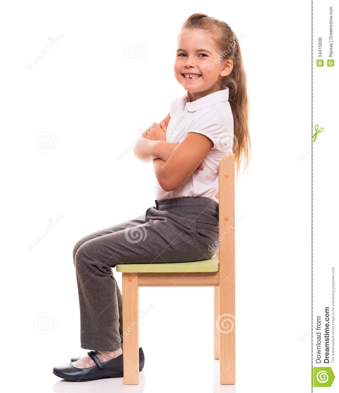 Little girl sitting on a chair and smiling stock photo for Sitting easy chairs