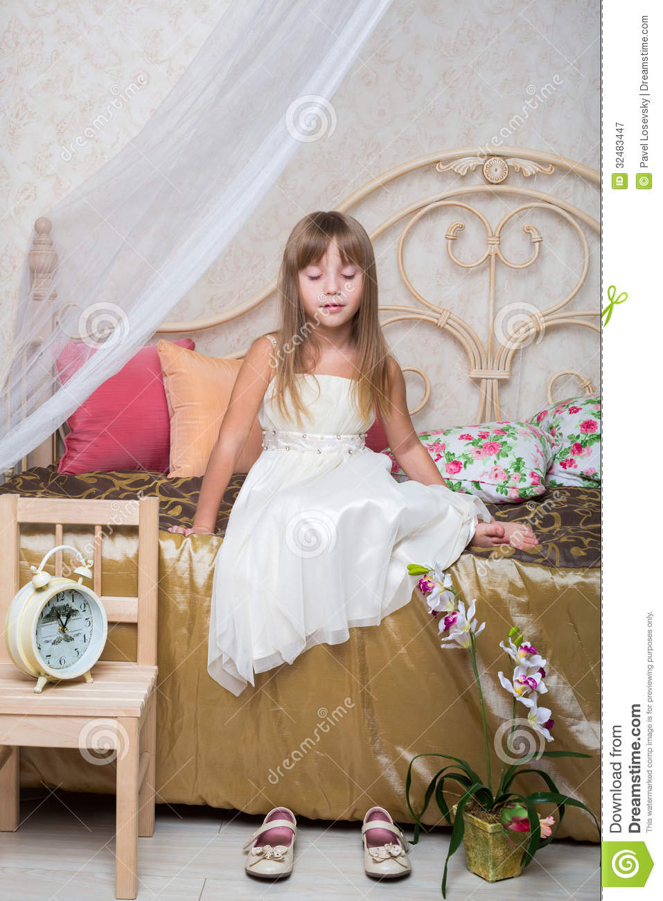 Girl With The Blog: A Little Girl Sitting With Eyes Closed On The Bed Stock