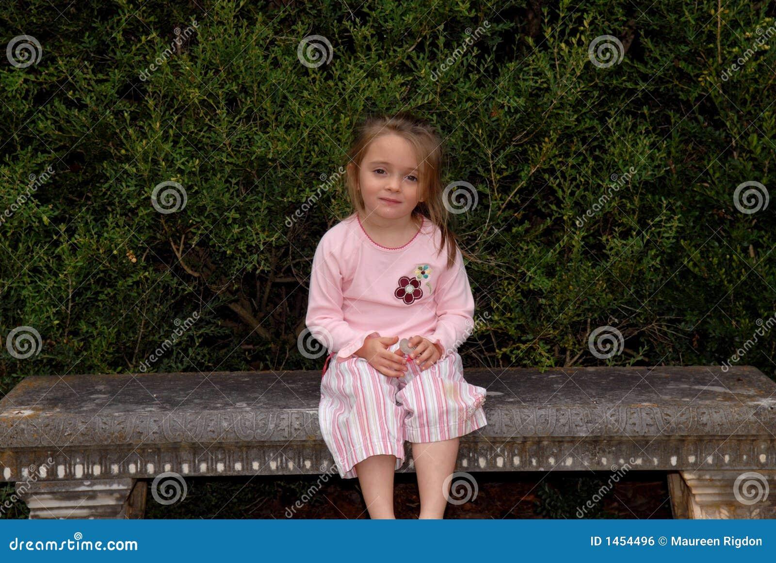 Little Girl Sitting On Garden Bench Stock Photo Image