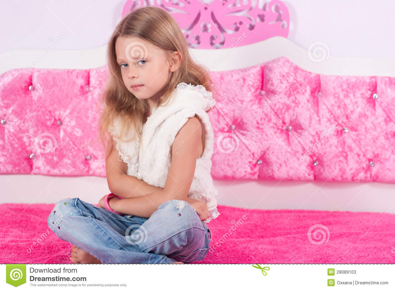 little girl sitting on a pink bed stock photos image