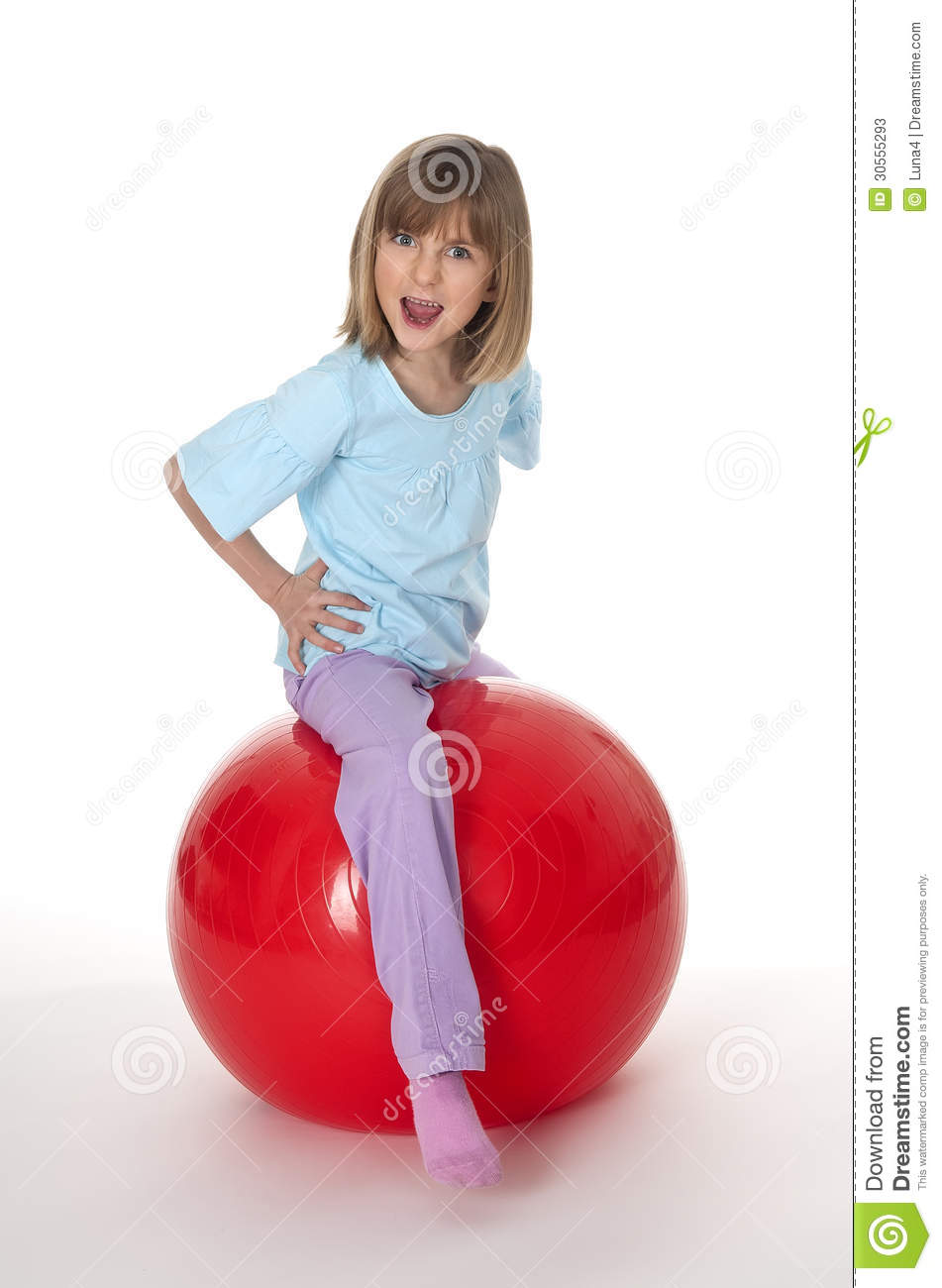 Little Girl Sitting On Red Gym Ball Stock Photos Image