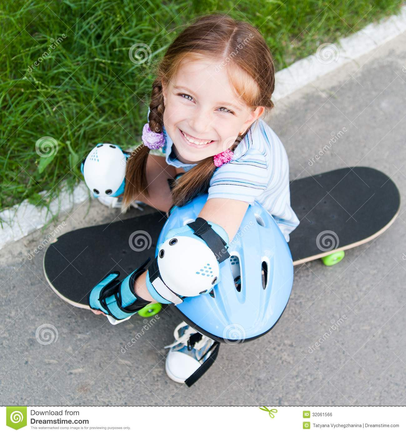 Amusing cute girl on skateboard are