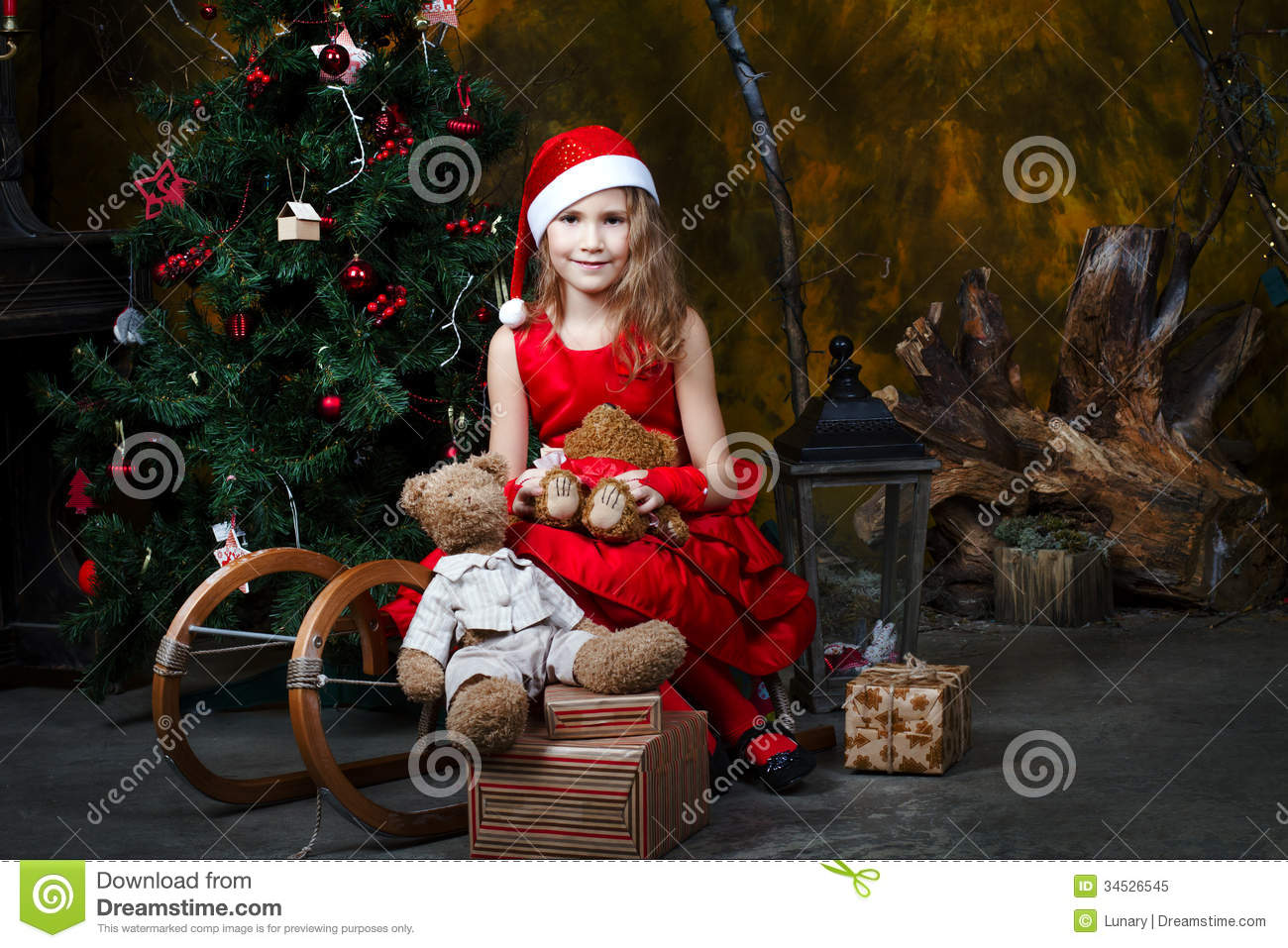 55373f76047e Royalty-Free Stock Photo. Little girl sitting on a sled with a Christmas  tree