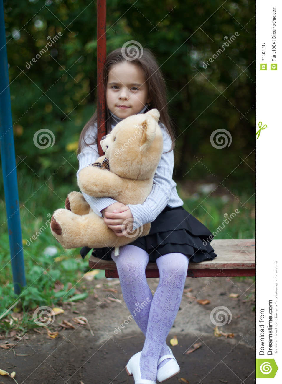 Little Girl Sitting On A Swing Royalty Free Stock