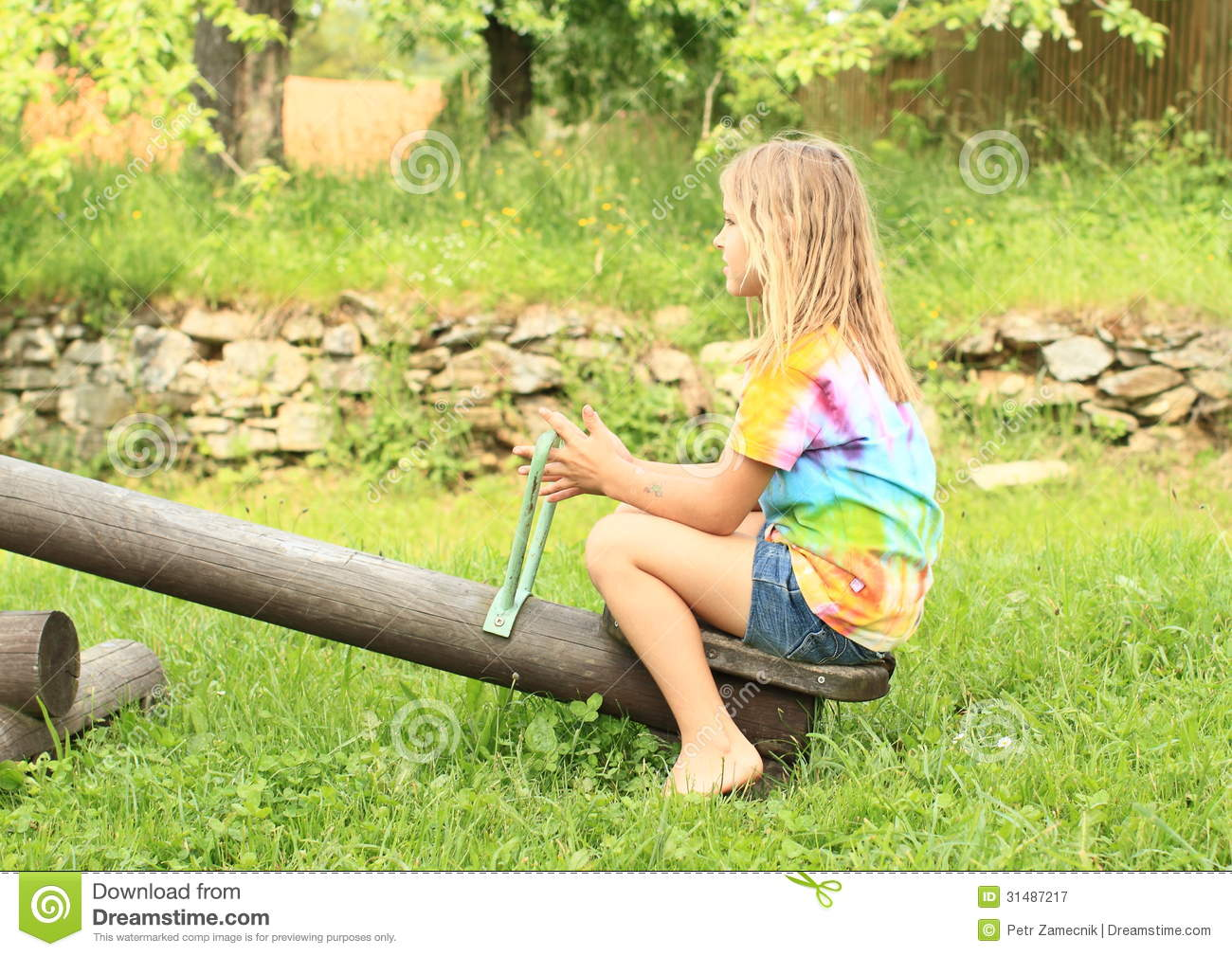 on swing sitting Girl