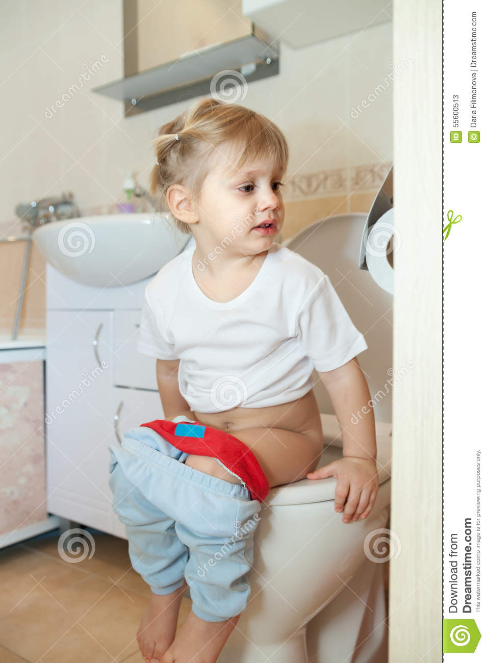 young boys sitting on toilet