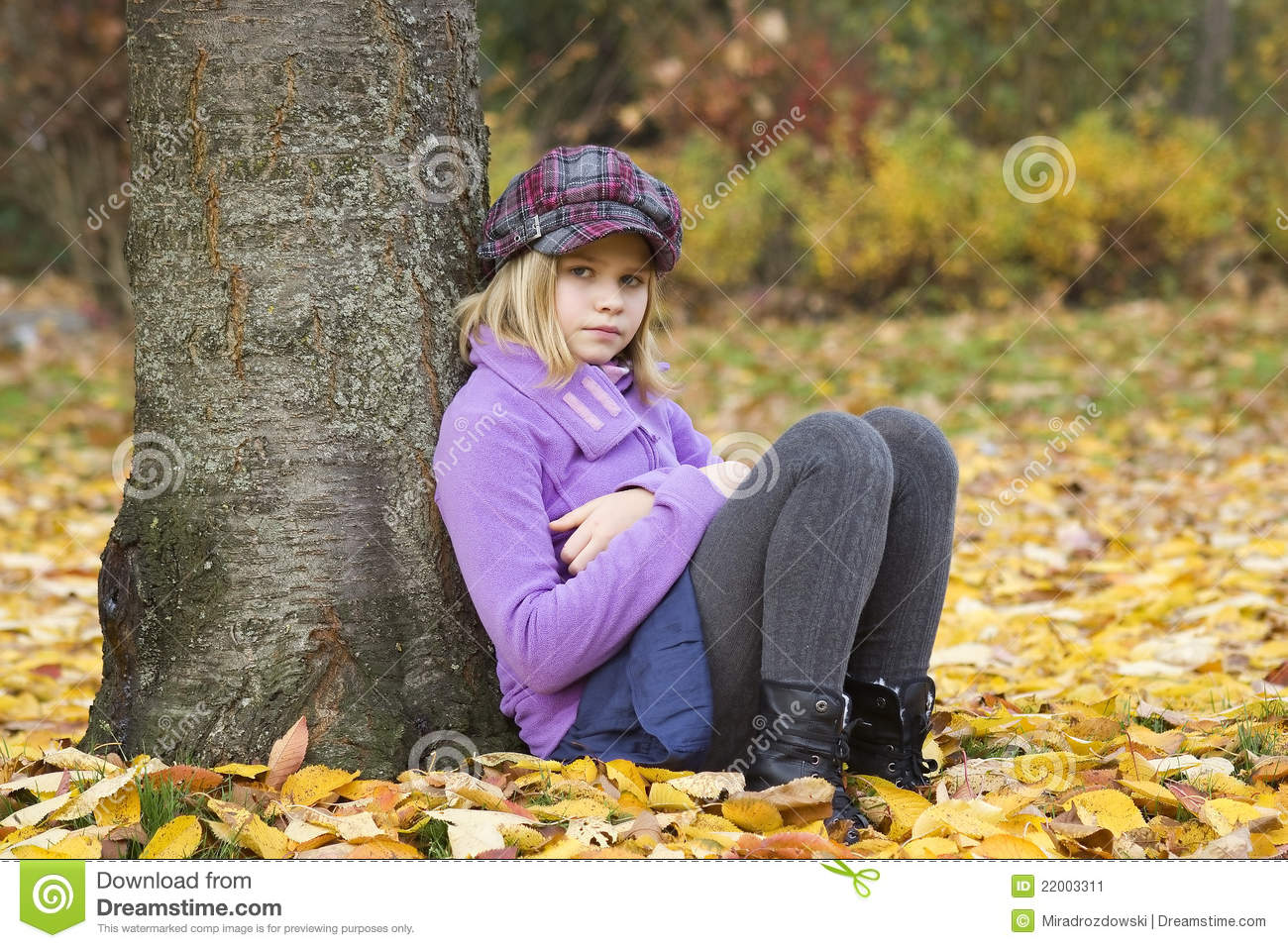 Beautiful Young Girl Reading Book While Sitting Under Giant Oak ...