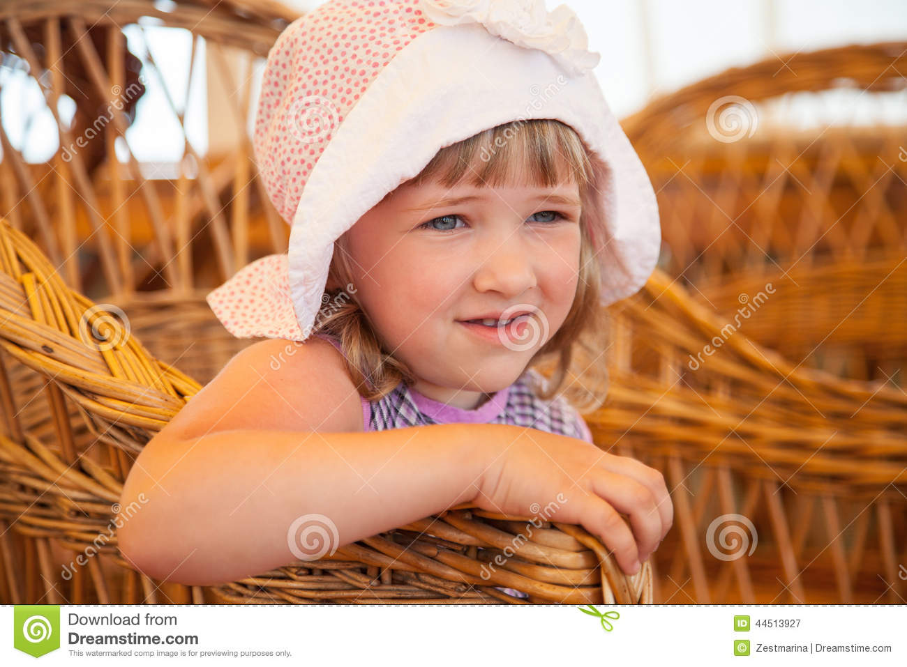 little girl sitting in a wicker chair stock image image 44513927. Black Bedroom Furniture Sets. Home Design Ideas