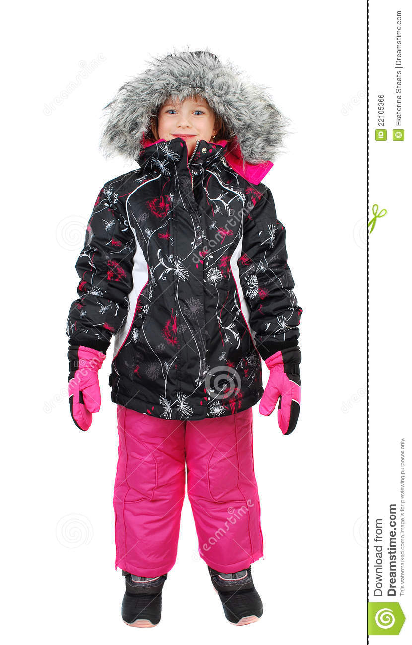 16815f09cd Little girl dressed in ski wear standing and isolated on white background.