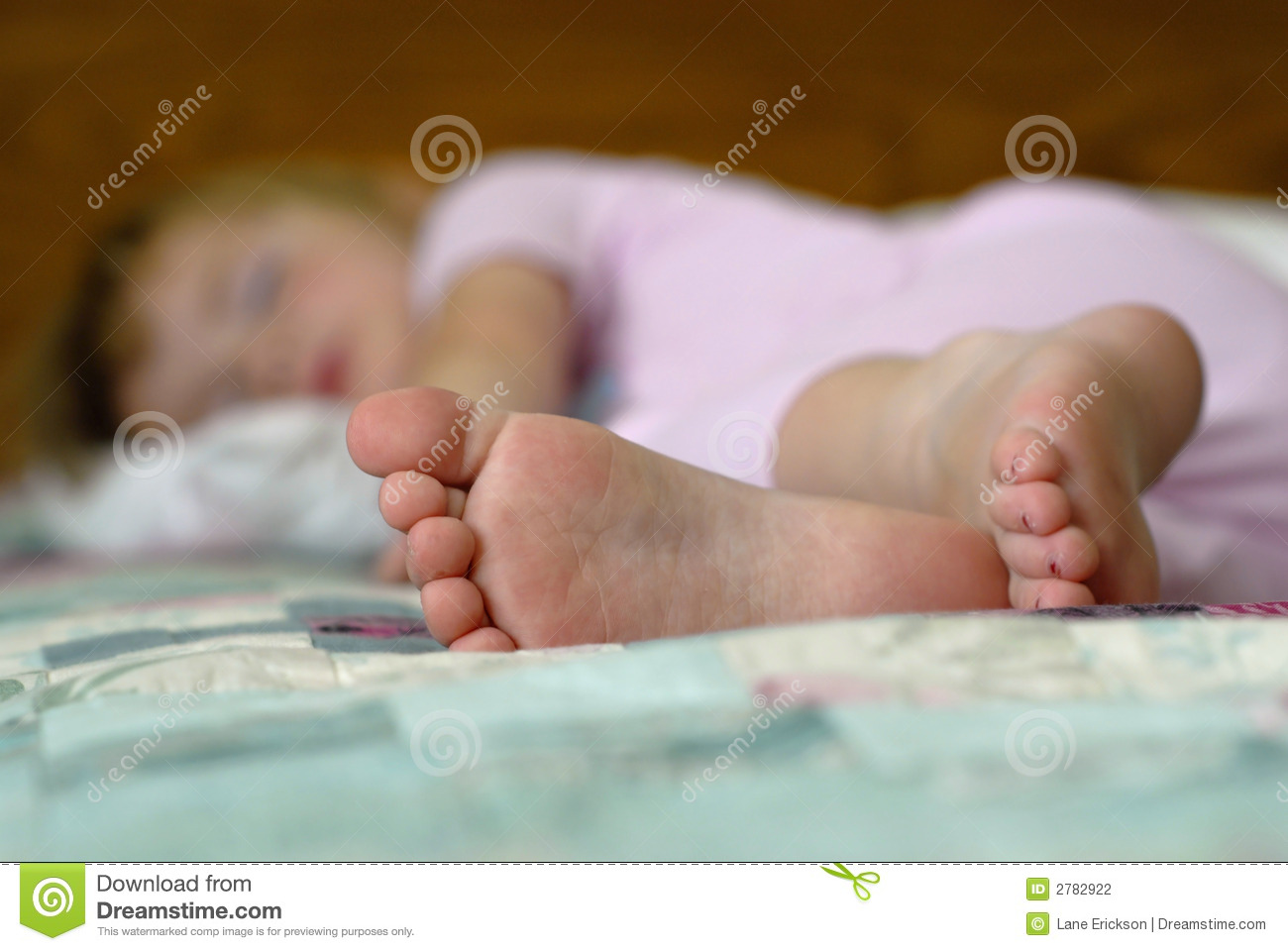 All little girl sleeping in bed feet ideal