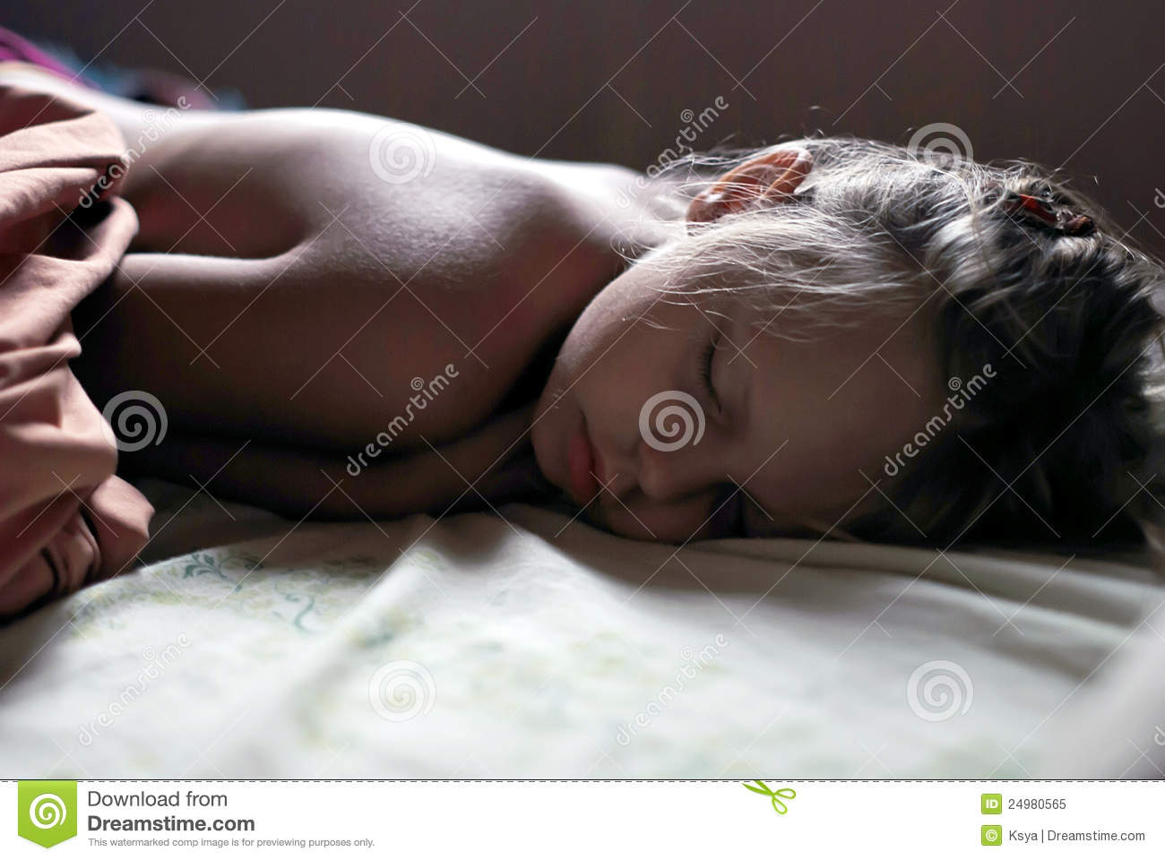 Little girl is sleeping well in her bed