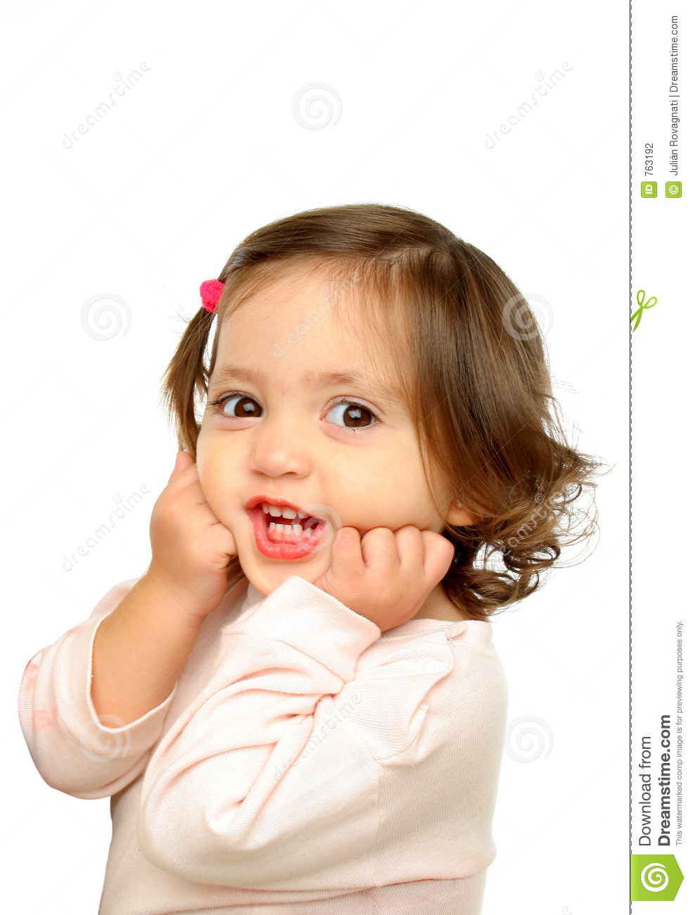 Little Girl Smiling At Camera Stock Photo