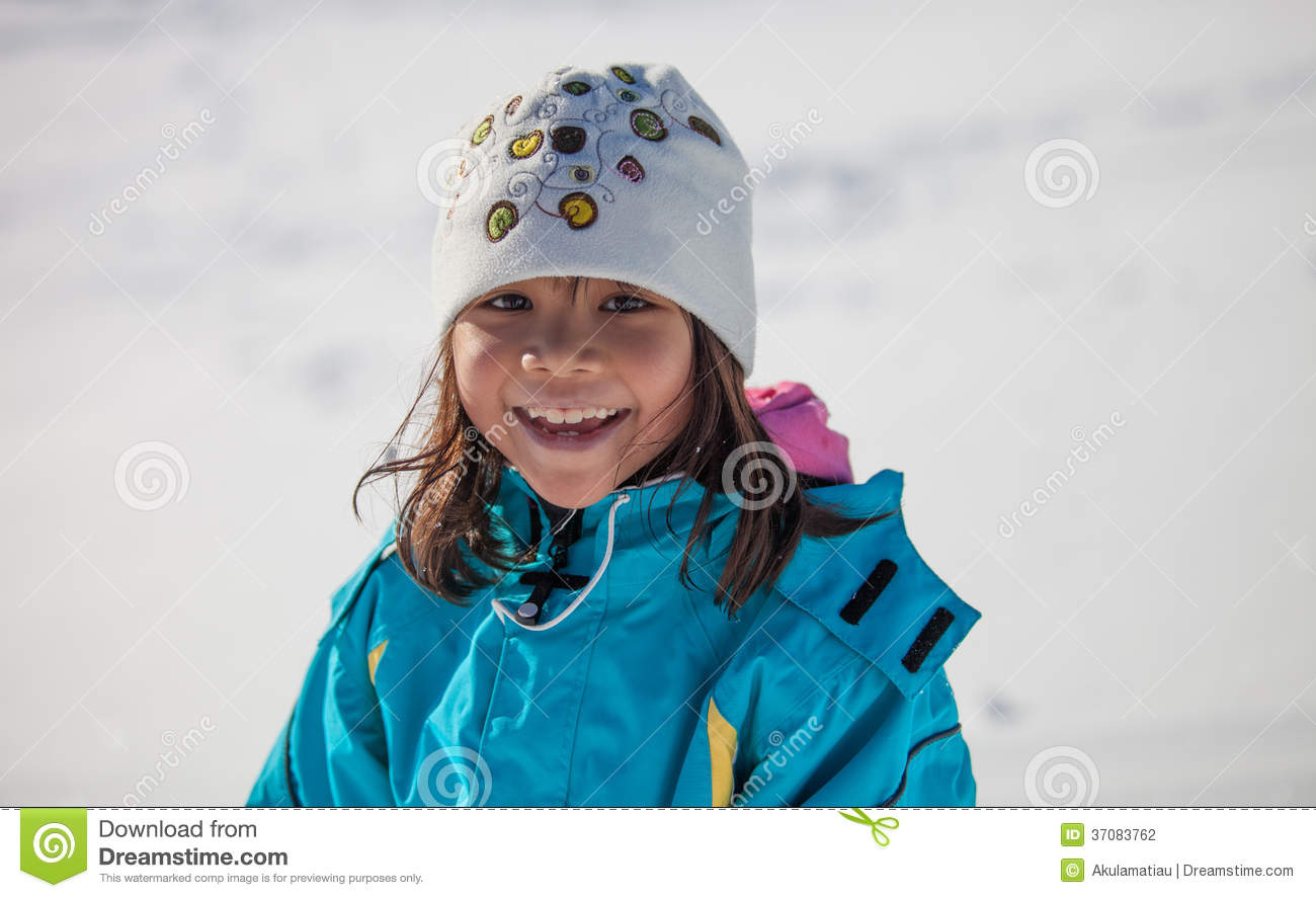 Little Girl Smiling In Winter