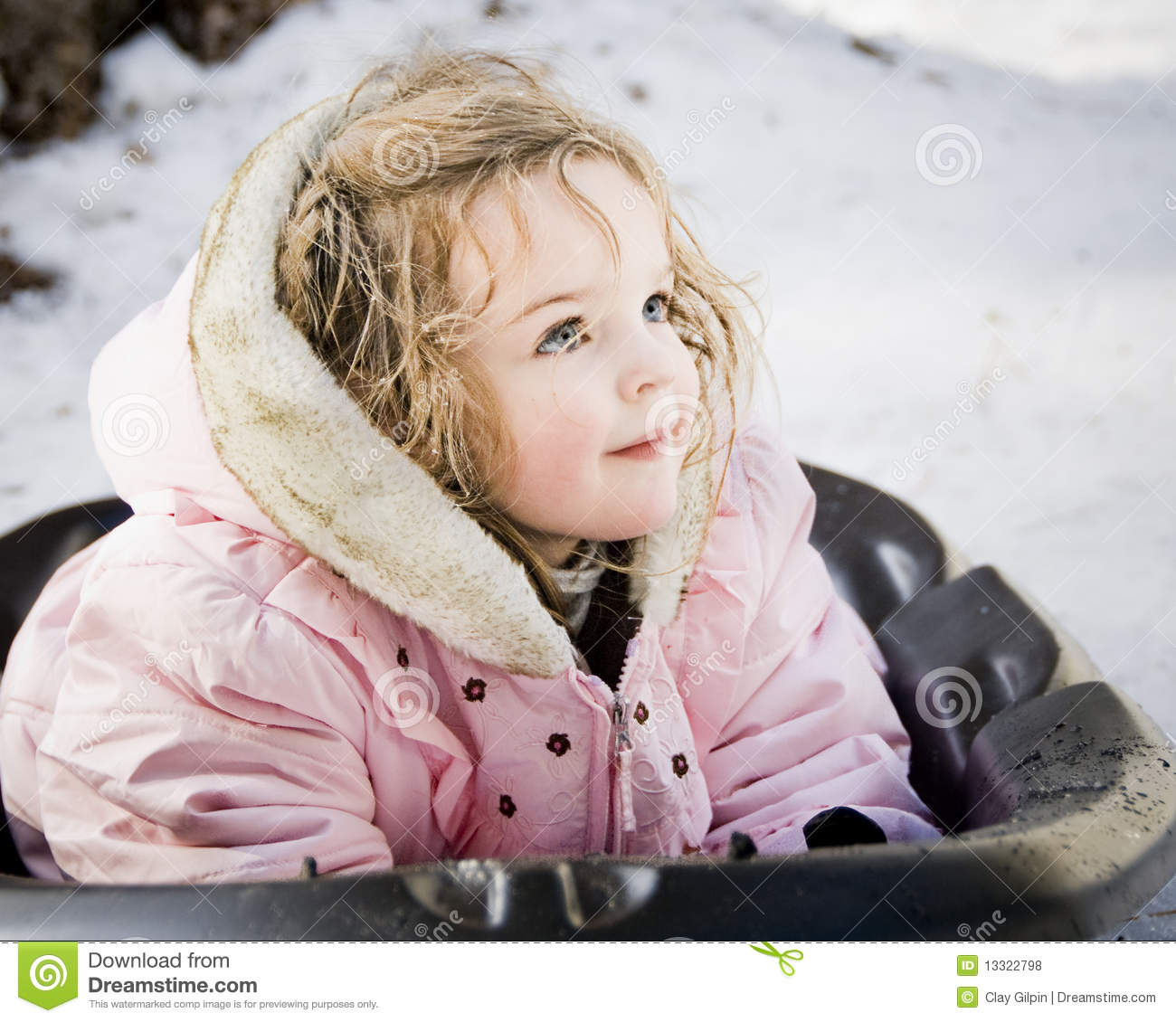 Little Girl On Snow Sled Royalty Free Stock Photos Image