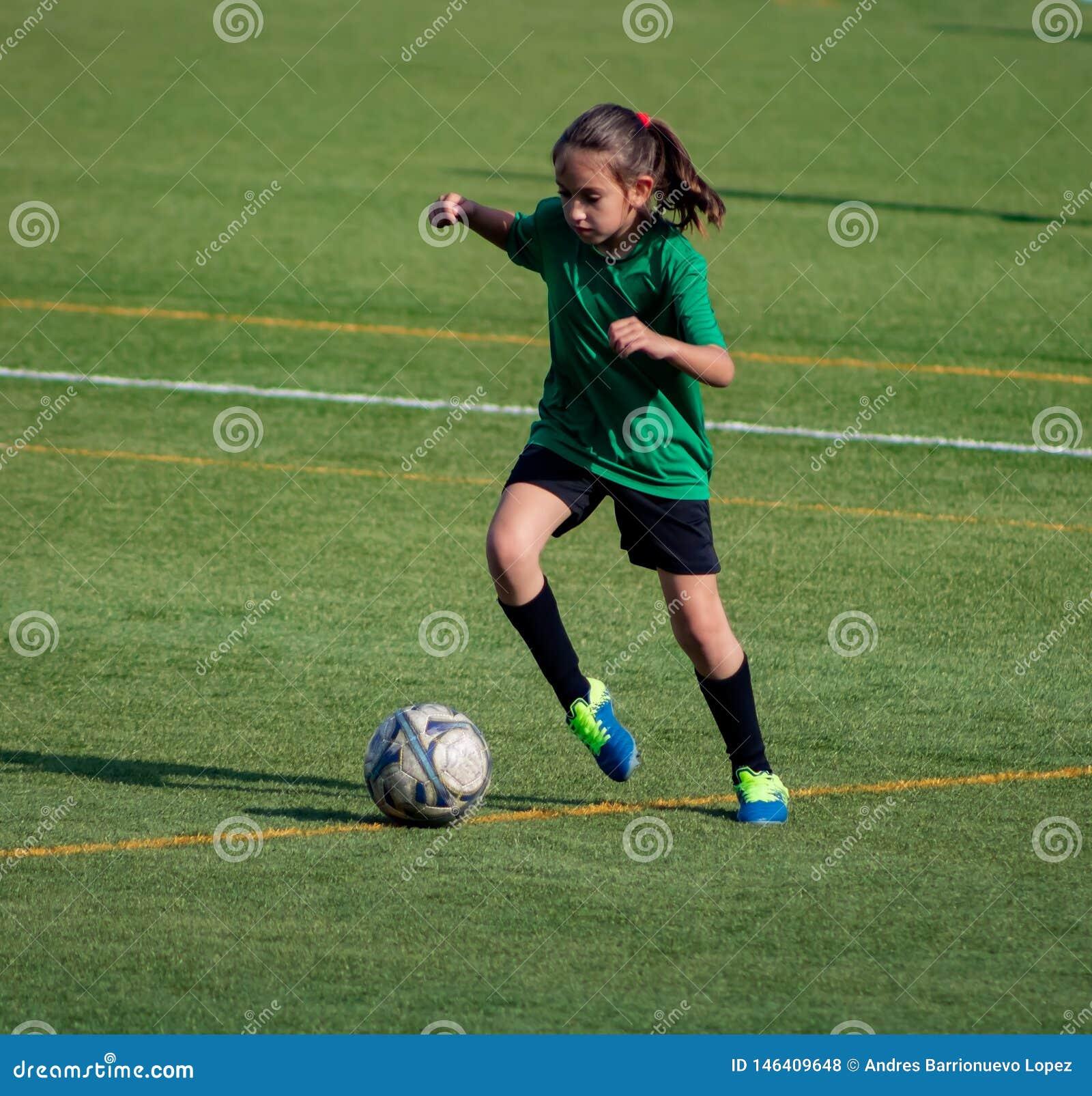 Little girl in a soccer training