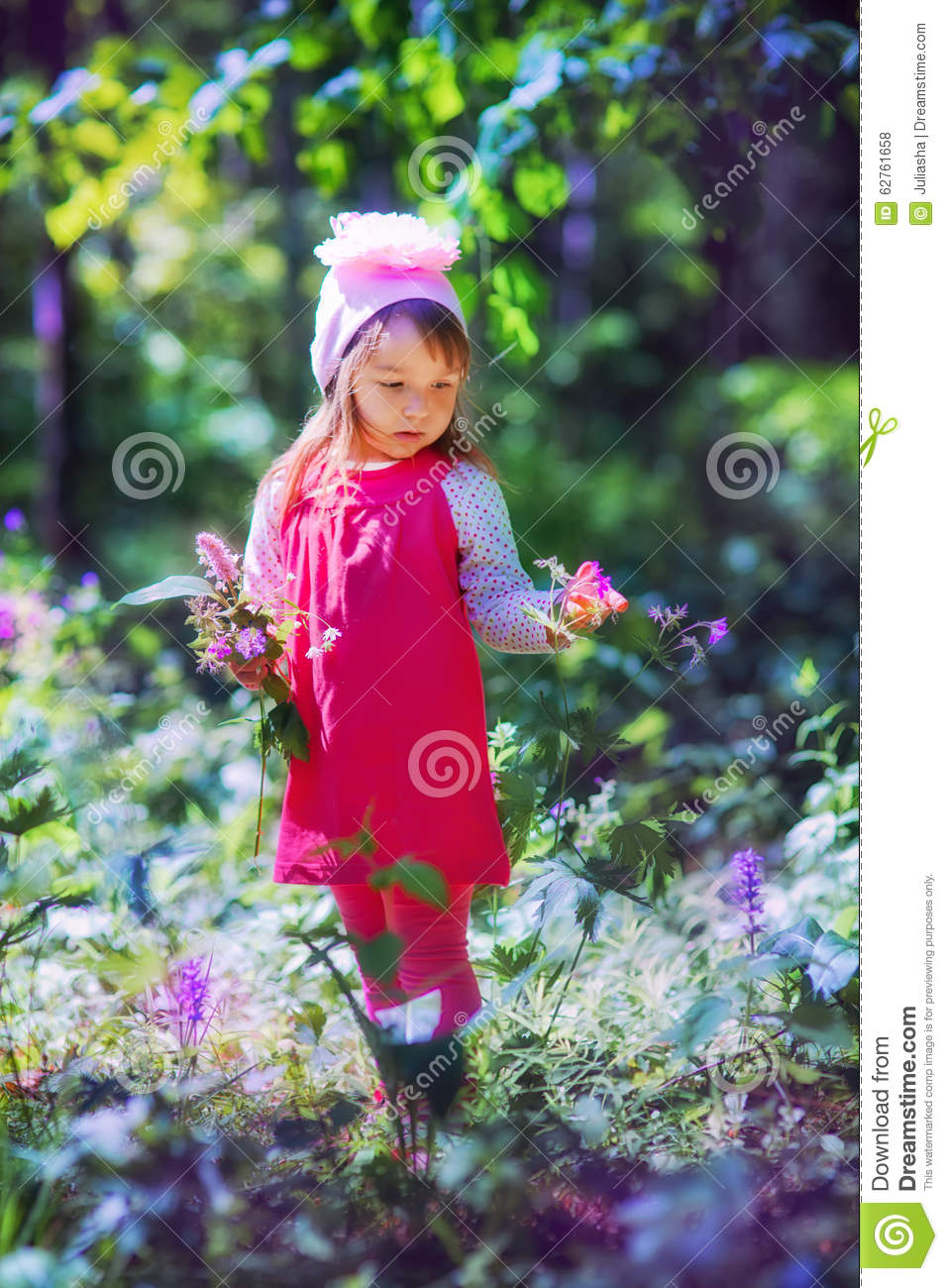 Little girl in sping forest