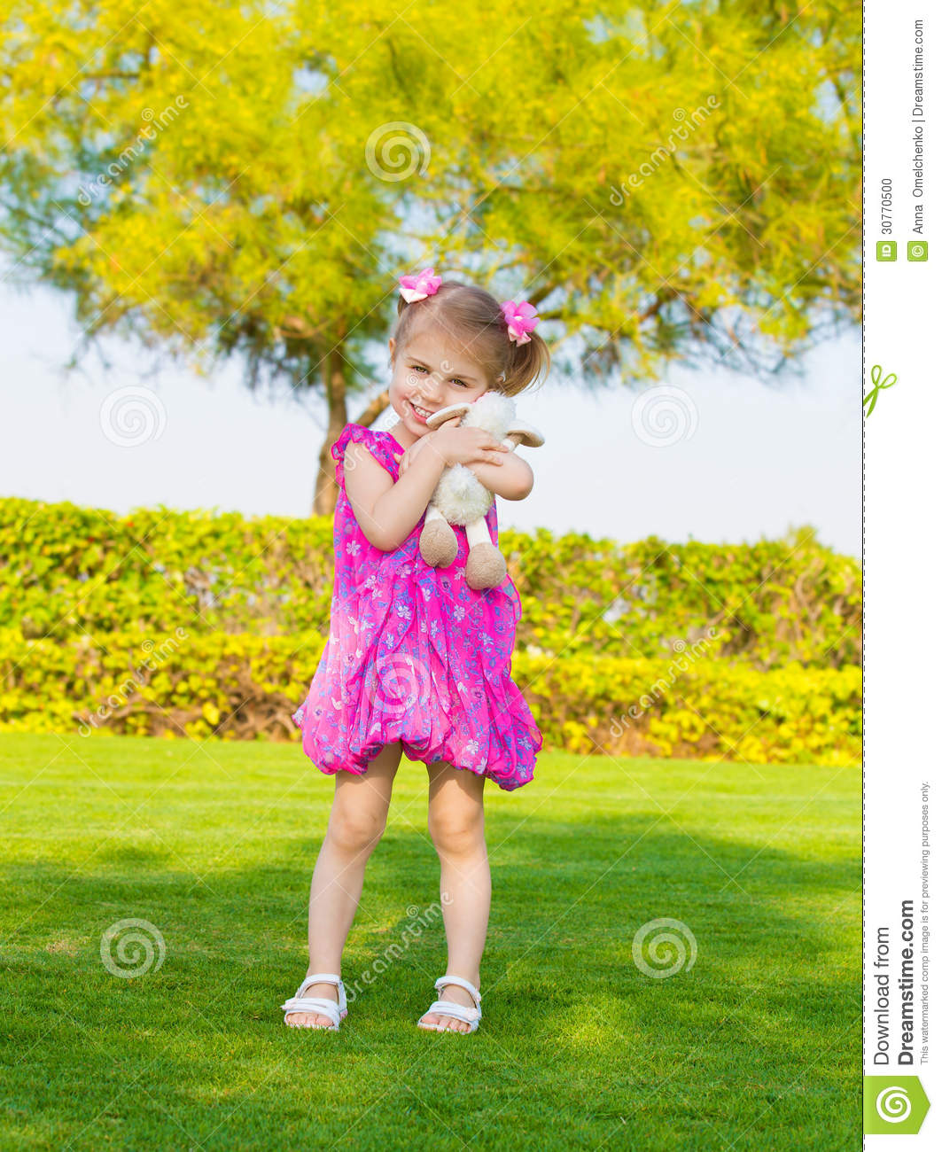 Adorable Little Girl Playing With Beach Toys During: Little Girl In Spring Park Stock Photo