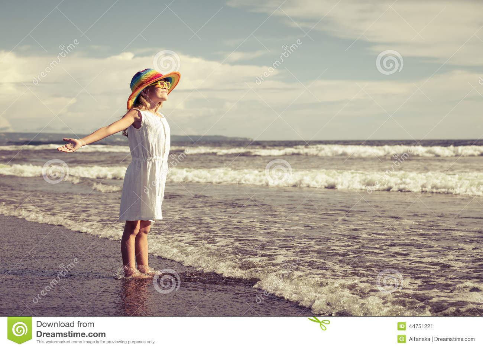 Little Girl Standing On The Beach - 162.4KB