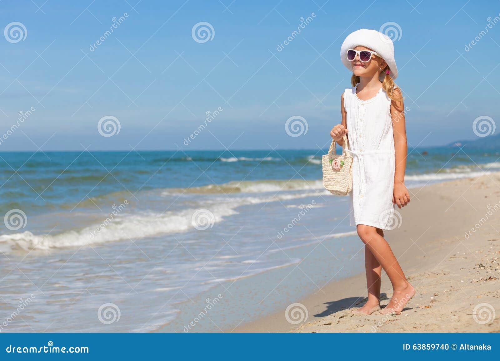 Little Girl Standing On The Beach - 104.0KB