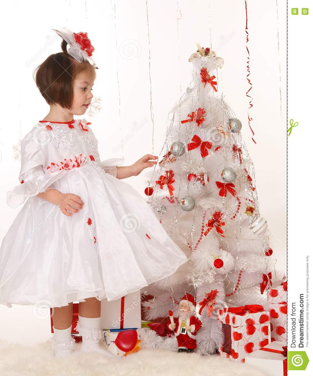 Little Girl Christmas Tree: Little Girl Standing Near A Christmas Tree Stock Photos