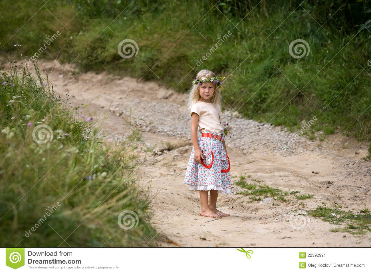 Little girl standing on the road