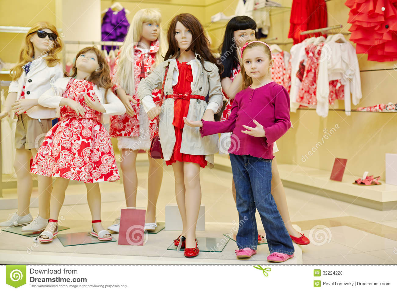 Little Girl Stands Together With Group Of Dressed