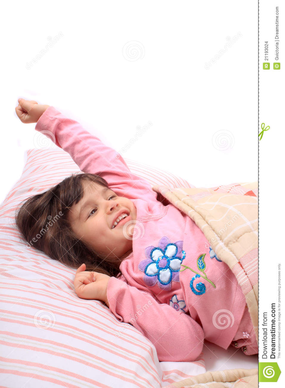 little girl stretching bed 21193024